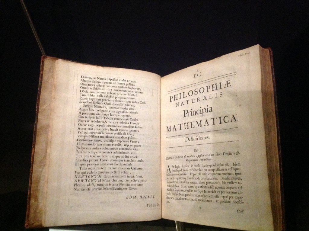 Newton's Principia, original Latin edition!  Edmond Halley, who persuaded Newton to publish, became the editor of the work, and wrote the poem on the left page to preface the text.