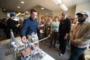 Nathan shows off his Mindstorms STM to President-elect Sarah Bolton