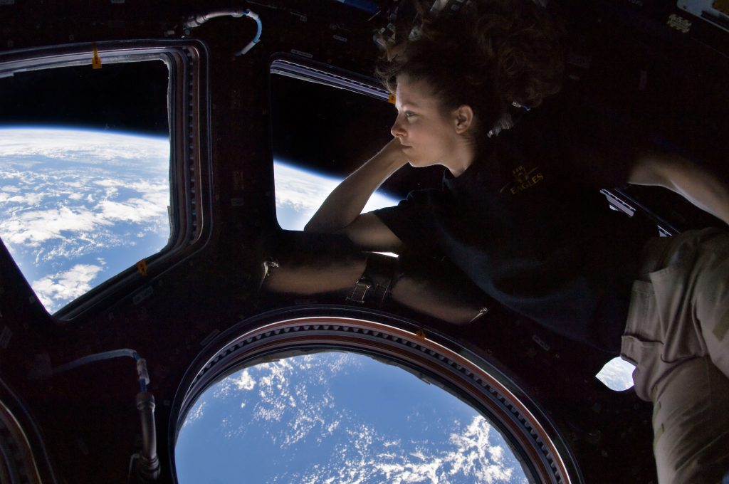 Astronaut Tracy Caldwell Dyson gazes down at Earth from the cupola onboard the International Space Station